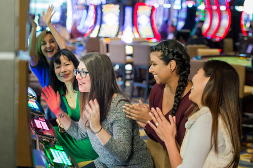 Friends playing slot machines
